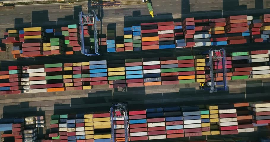 Odessa, Ukraine - 24 July 2017: Big warehouse with many multicolored containers. There are cranes and trucks. Aerial video recording. Editorial. | Shutterstock HD Video #1009566791