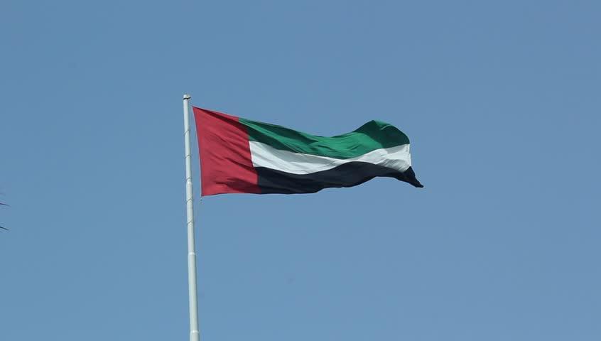 united arab emirates use flag on sunny blue sky
