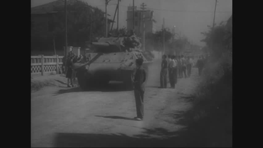 CIRCA 1944 - The 5th Army enters Rome and takes German POW's.