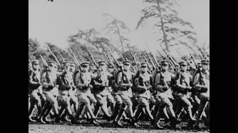 CIRCA 1940s- Japanese political figures attend a political caucus, and members of the Japanese military march in formation.