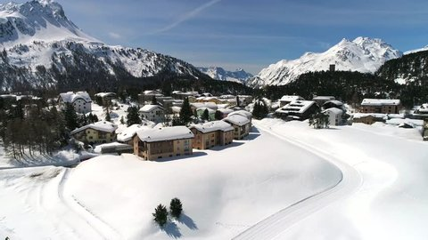 Winter season in Engadine, village of Maloja. Aerial view with drone
