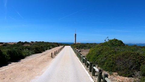Driving towards Ponta do Altar lighthouse, located in Ferragudo, Algarve south of Portugal