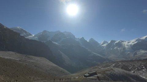 Undefined trekkers walking on trekking trail in Nepal
