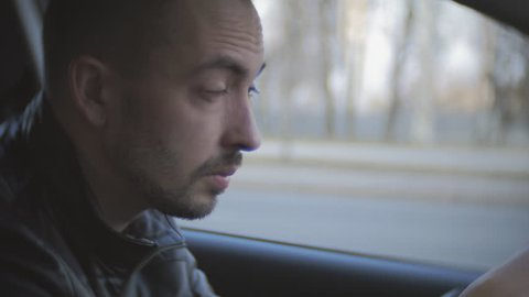 Fatigue driving car. A man rides on the vehicle of exhaustion and falls asleep.
