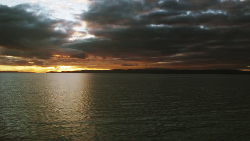 Low Flying Drone Over Water At Sunset | Shutterstock HD Video #1009672991
