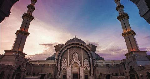 Sunset time lapse at the majestic Federal Territory Mosque (public mosque) or Masjid Wilayah in Kuala Lumpur, Malaysia.Beautiful sky color changing and dancing cloud.Camera tilt up.