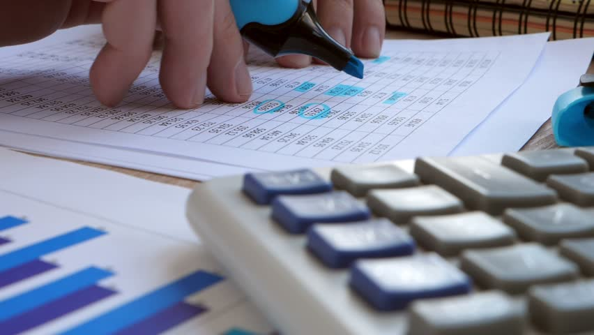 Accountant checking financial report or accounting book. Working in the office. | Shutterstock HD Video #1009678841