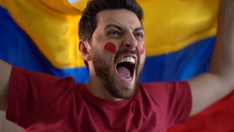 Colombian fan celebrating at home