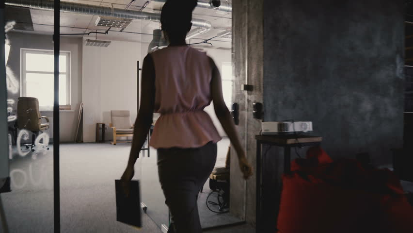 Camera follows African American female business coach enter office, motivate and inspire multiethnic workers team 4K. | Shutterstock HD Video #1009712111