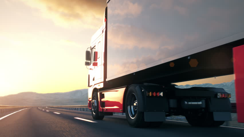 A semi truck passes the camera driving on a highway into the sunset, back-view low angle camera. Realistic high quality 3d animation.