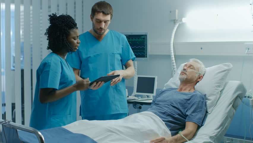 In the Hospital, Senior Man Lying in the Bed, Talks with Doctor and Nurse who Diagnose Him Using Tablet Computer. Technology Helps CurePatients, Modern Hospital Ward. Shot on RED EPIC-W 8K Camera. | Shutterstock HD Video #1009727981