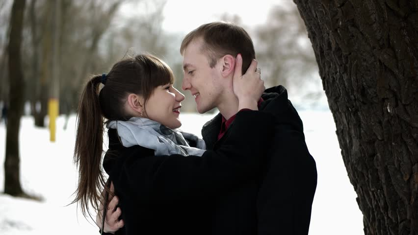 Couple in love kissing. A loving couple walking in the park. Portrait of a white European couples in love. A kiss near a tree. Loving couple smiling. The embrace of a couple in love. | Shutterstock HD Video #1009742141