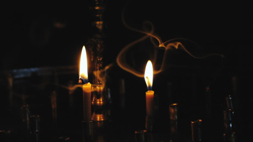 Inflamed scented candles in the dark | Shutterstock HD Video #1009749191