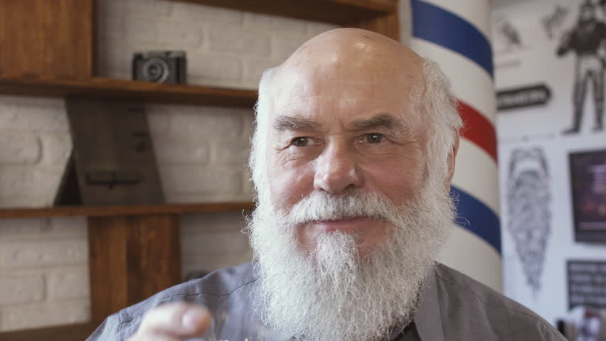 Handsome mature man drinks whiskey | Shutterstock HD Video #1009761161