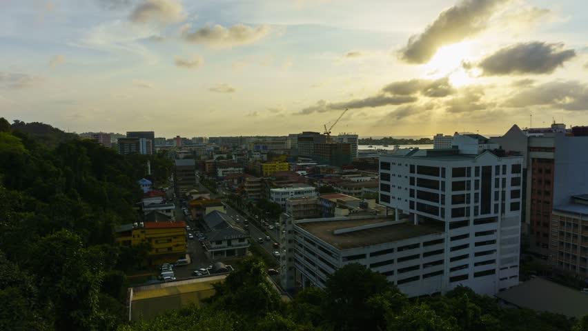 Kota Kinabalu, Sabah, Malaysia-Febuary 10,2018: Time-lapse of Kota Kinabalu City with amazing sunset from day to night at Signal Hills Kota Kinabalu, Sabah, Malaysia in 4k resolution