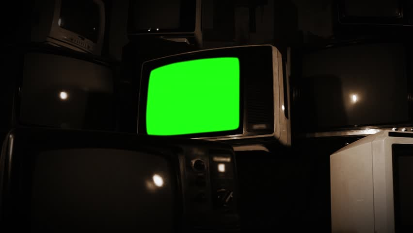 "Old TV with Green Screen over a Pile of Old TVs. Sepia Tone. Zoom In Fast. You can replace green screen with the footage or picture you want with ""Keying"" effect in AE  (check out tutorials). 