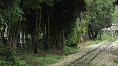 Vintage steam train passes by railroad in Minas Gerais old colonial Brazil