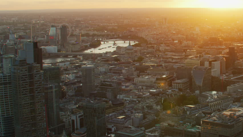Aerial view with sun flare sunset over London cityscape commercial and residential buildings and apartments England United Kingdom   | Shutterstock HD Video #1009779941
