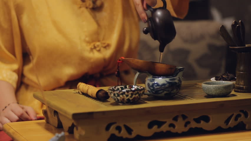 Oriental female making herbal tea European tourists, Chinese cultural activity