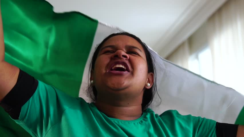 Nigeria Woman Celebrating with National Flag