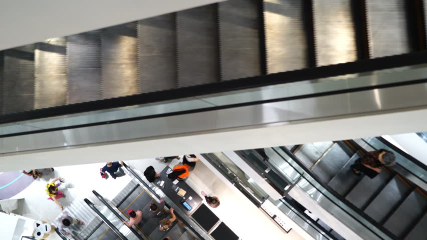 Mall Center Escalators, people going to shopping.   Shutterstock HD Video #1009904621