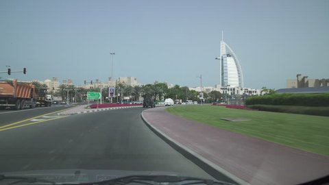 Dubai, UAE - April 01, 2018: Travel on the roads of Dubai, Burj Al Arab Hotel, view from the car window stock footage video