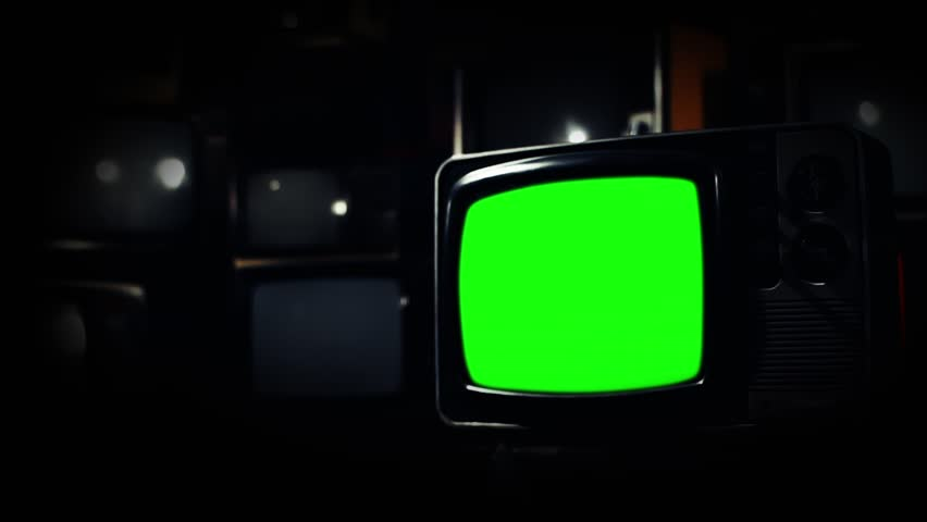 Vintage 80s Tv with Green Screen. Gold Rush Tone. Zoom Out. Ready to replace green screen with any footage or picture you want.  | Shutterstock HD Video #1009948391
