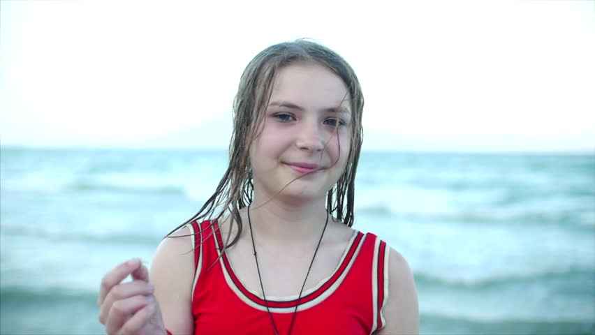 Close up, portrait of beautiful young teenage girl looking at camera smiling, tropical beach slow motion. Stock footage. | Shutterstock HD Video #1009954331