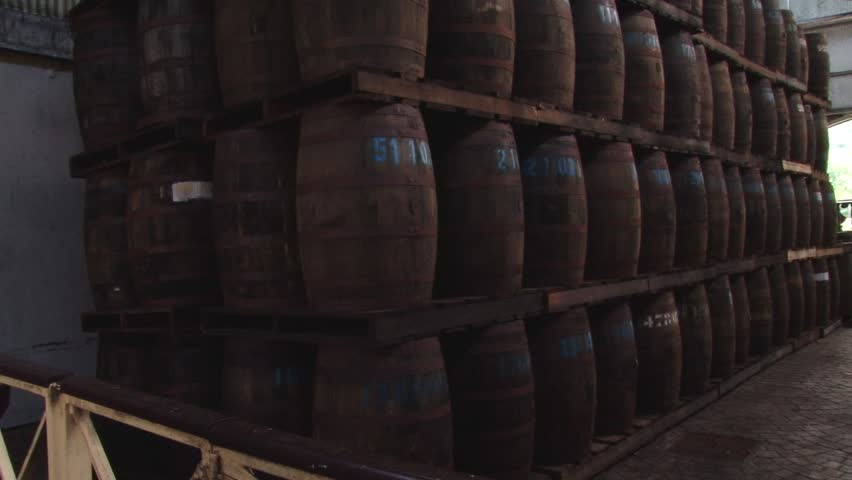 Tilt up of Depaz wooden barrels with rhum at distillery on northern part of Martinique island