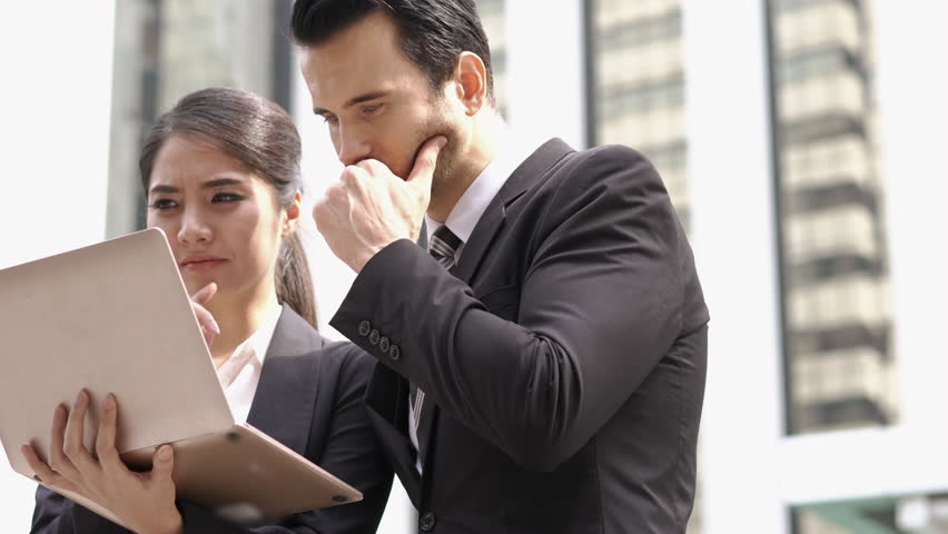 Businessman and Businesswoman talking discuss project together. Concept of project management, business meeting, strategy and performance.   Shutterstock HD Video #1009963121