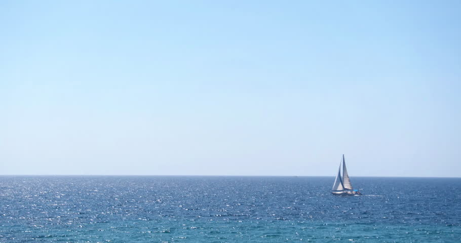 ALGHERO, SARDINIA, ITALY – JULY 2016 : Video shot of boat on a sunny day with sea and the horizon in view