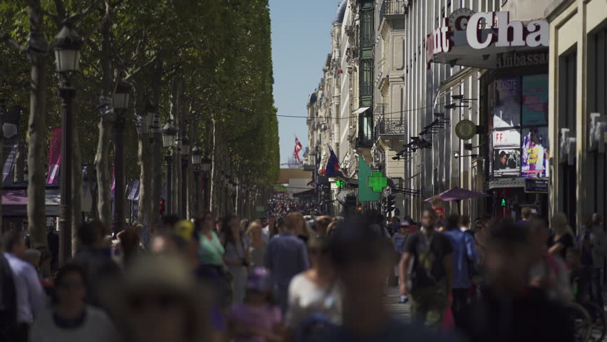 PARIS, FRANCE – SEPTEMBER 2016 : Video shot of people walking in central Paris on a beautiful day | Shutterstock HD Video #1009990691