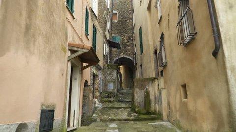 A narrow pedestrian street in the old town of Perinaldo, Imperia province, Liguria region, Italy