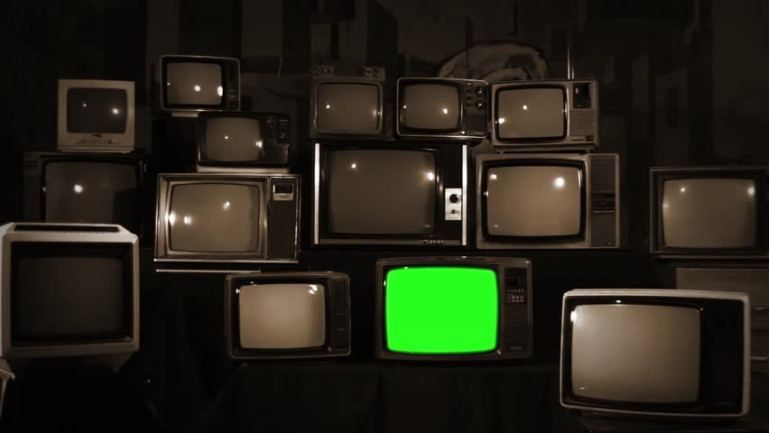 Aesthetic Televisions of the 80s with Green Screens that Light Up. Sepia Tone. Zoom In. Ready to replace green screen with any footage or picture you want.  | Shutterstock HD Video #1010055191