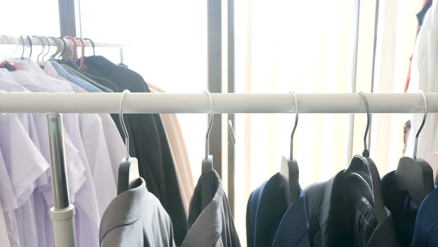Solly footage of hanger in a store with male business clothes on it | Shutterstock HD Video #1010055251