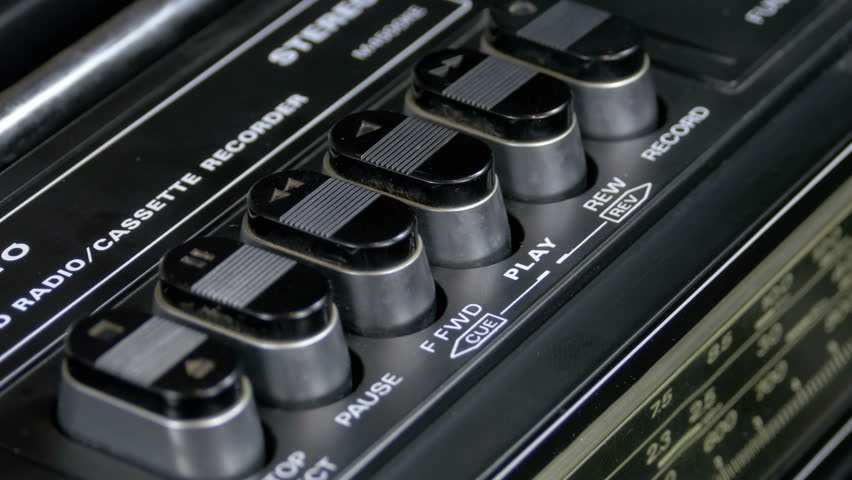Pushing Play Button on a Vintage Tape Recorder. Close-up. Pushing a Finger Button Play. Man finger presses playback control buttons on audio cassette player   Shutterstock HD Video #1010058521