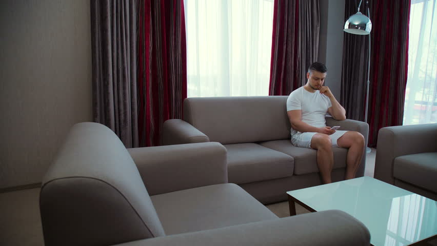 Technology communication mobile phone. modern gadgets. digital device addiction. adult caucasian man using smartphone at home | Shutterstock HD Video #1010108801