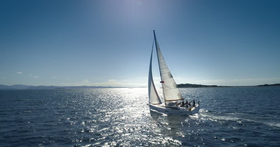 Yacht sailing on opened sea.  Yachting with sails up at windy day. | Shutterstock HD Video #1010118101