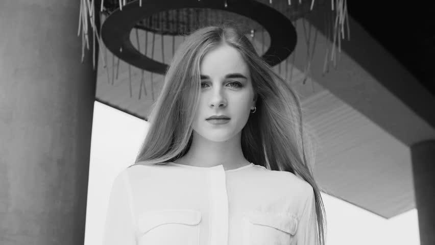 Summer lifestyle fashion portrait of young beautiful blonde stylish hipster woman wearing white shirt   Shutterstock HD Video #1010148311