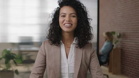 portrait of beautiful stylish hispanic business woman smiling happy confident looking at camera arms crossed enjoying management opportunity real people series