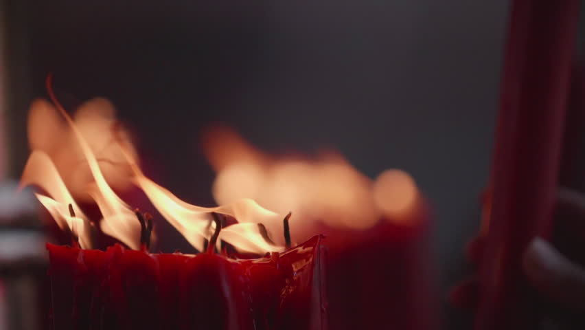 People light up candle in slow motion | Shutterstock HD Video #1010203331