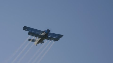 Old crop duster flying overhead.
