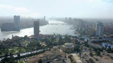 Enjoy aerial cityscape of two cities from the top of Cairo Tower, overlooking Cairo, Giza, Gezira Island and curved Nile river, Egypt.