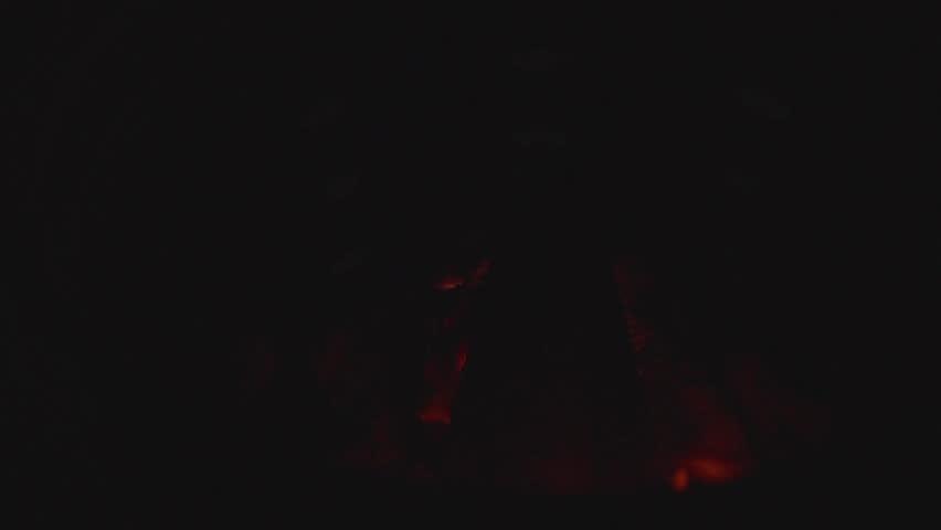 Slow motion shot of joss paper money being burnt