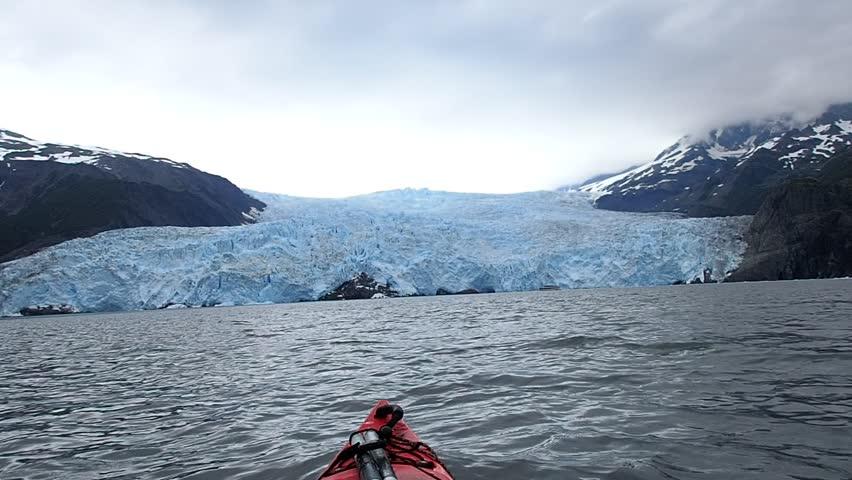 Sea kayak trip to Ailik Glacier, Resurrection Bay, Kenai Fjords National Parknear Seward, Alaska, United States on gloomy, cloudy day