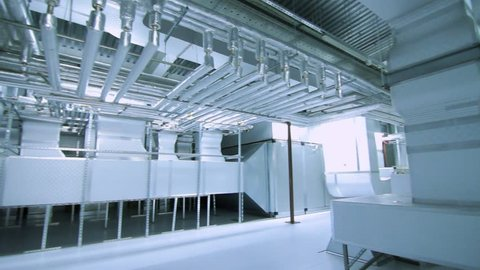 Modern equipment of industrial factory. Pipelines, air ventilation system at modern factory. Pharmaceutical factory interior. Ventilation system of industrial plant