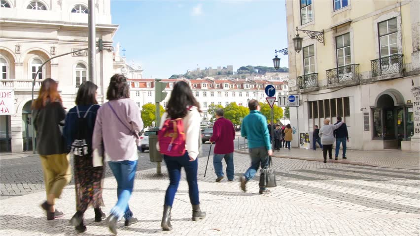 City life, tourists stroll through the streets of Lisbon, Portugal | Shutterstock HD Video #1010292851