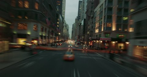 Time lapse of taxis and cars driving around New York Coty in the evening with light streaks.
