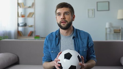 Hopeless fan disappointed at bad game of national football team, competition