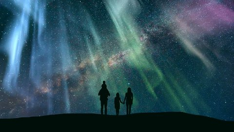 The family standing against the starry sky with a northern light. time lapse